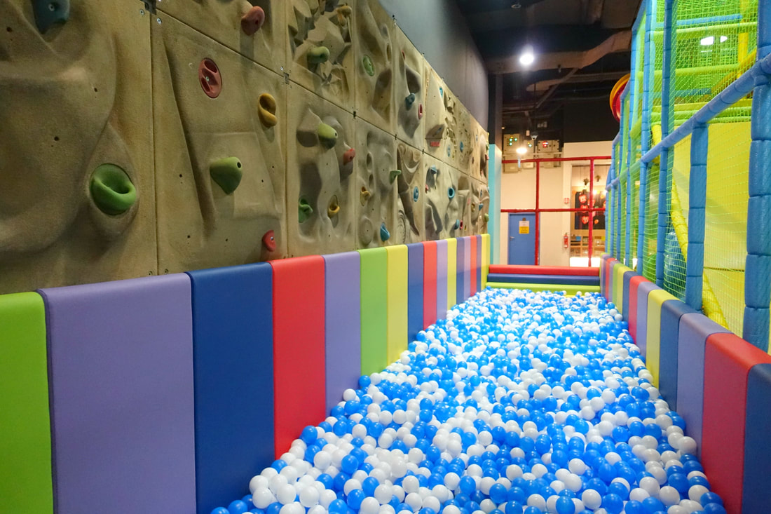 A fun ball pit is situated right next to the playgym and there is a rock wall course that older kids can attempt here.