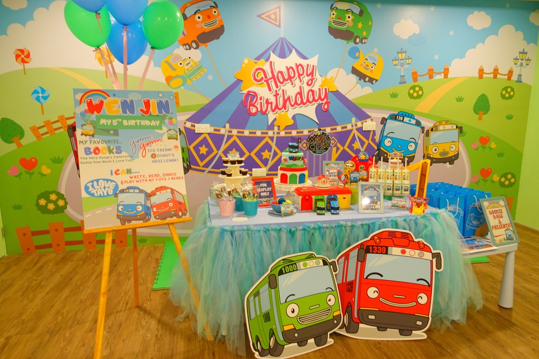 A birthday party set up for a boy. Blue and Green predominant colors!