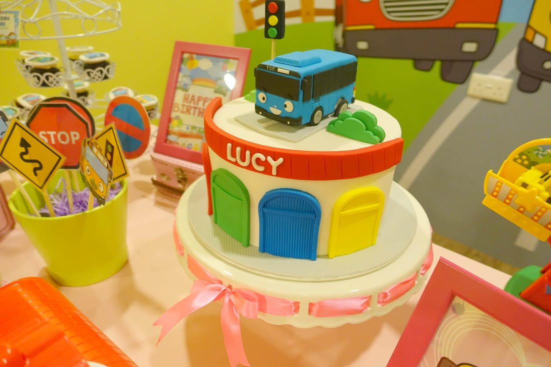 Look at the adorable birthday cake! Love that Tayo bus on top and the parking garage design at the front!