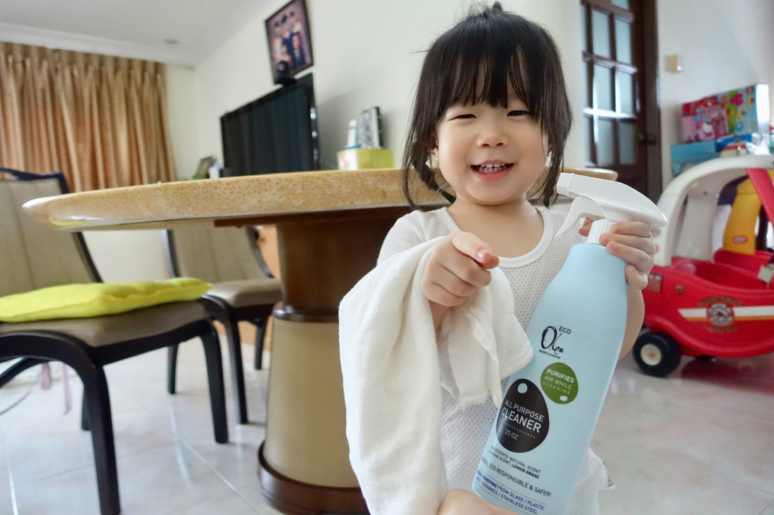Mae the little cleaner, ready to get to work with a cloth and the Olea Essence Eco All-Purpose Cleaner!